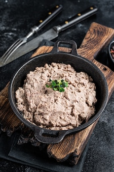 Duck pate rillettes de canard in a pan with greens.   top view.