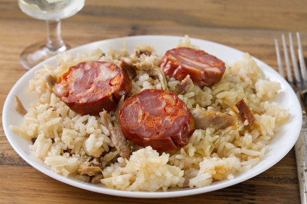 Duck rice with chorizo on plate