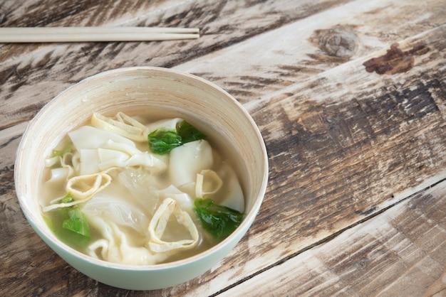 Duk mandu guk (korean dumpling soup)