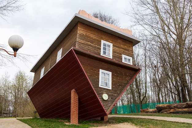 Dukora, belarus - april 20, 2019: an inverted house in the village of dukora in belarus