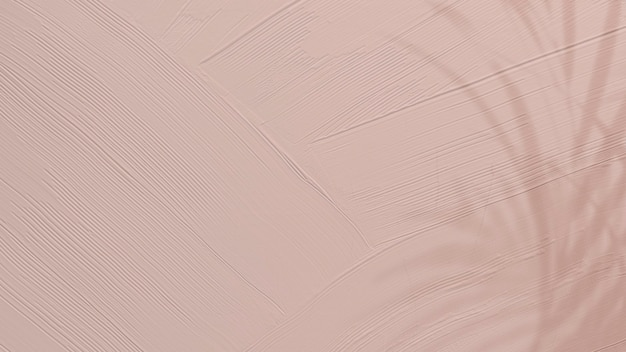 Dull pink paint texture background with leaf shadow