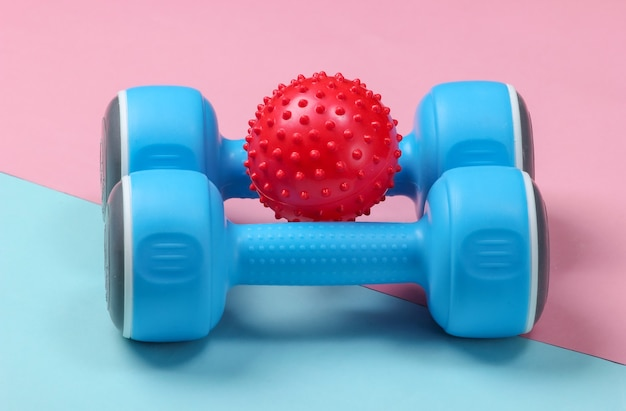 Dumbbell with massage ball on blue pink pastel