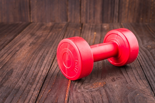 Dumbbell on wood background