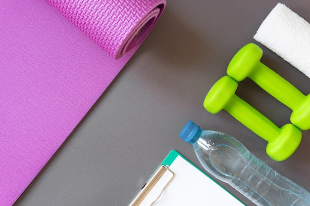 Dumbbells on background the concept of a healthy lifestyle