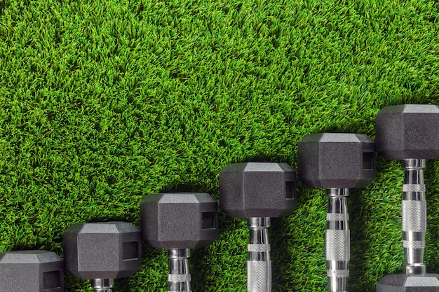 Dumbbells on the grass.