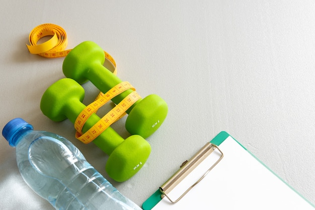 Dumbbells on a gray background the concept of a healthy lifestyle