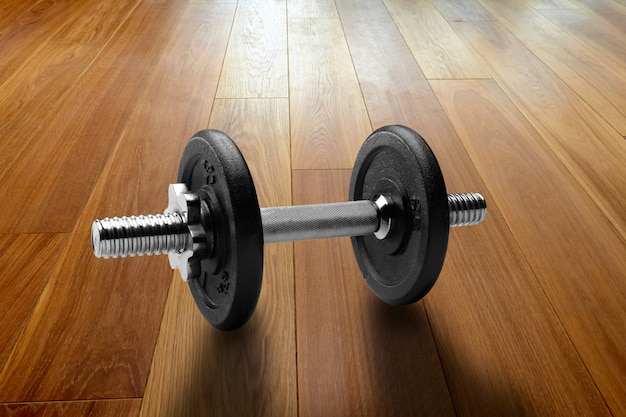 Dumbbells on hardwood floor in renovated house