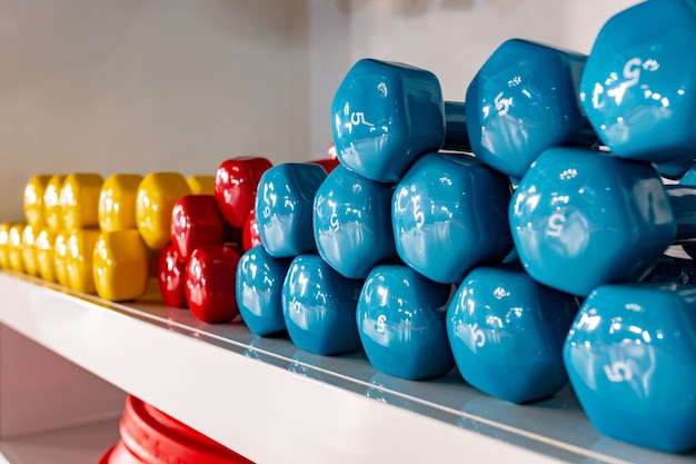 Dumbbells lying on the shelves. gym. equipment for a sports hall.