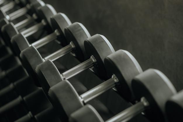 Dumbbells on rack in gym