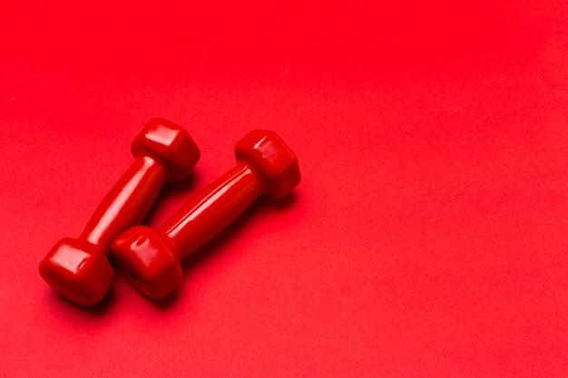 Dumbbells on a red background