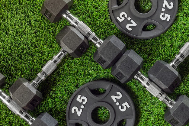 Dumbbells and weights on the grass