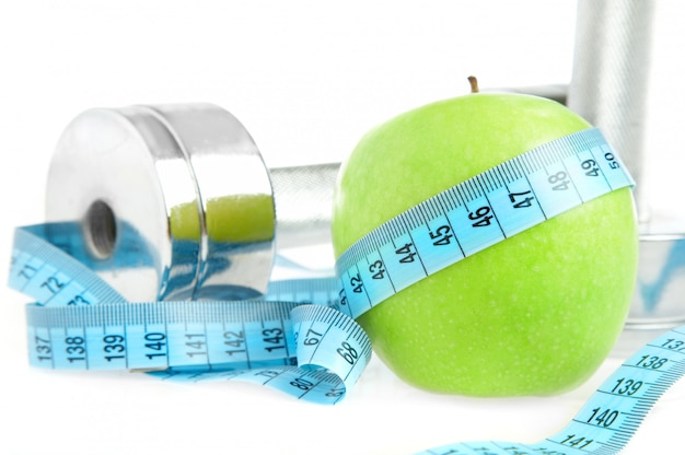 Dumbbells with an apple . a healthy way of life