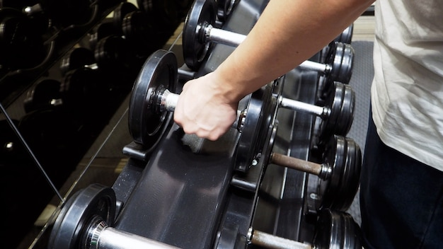 Dumbbells with arm equipment in fitness.