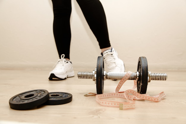 Dumbbells with measuring tape on it