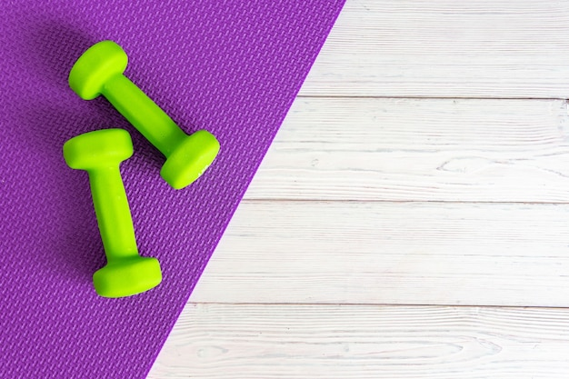 Dumbbells on a wooden background the concept of a healthy lifestyle