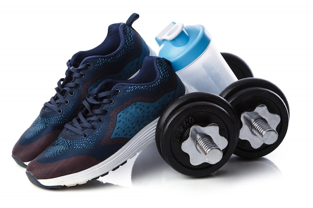 Dumbells, sneakers and shaker