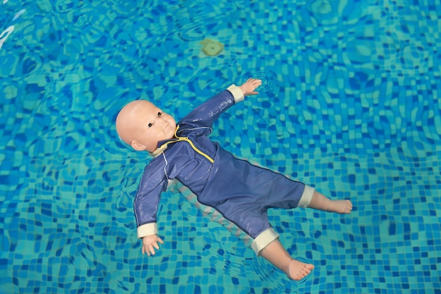 Dummy drowning training baby doll float in the pool.