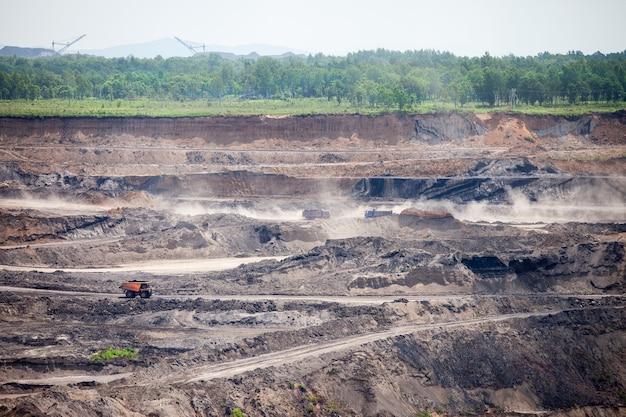 Dump trucks working at open coal mine