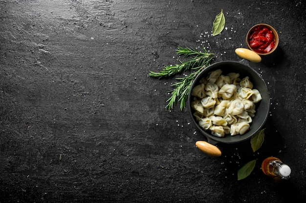 Dumplings in a pot of rosemary.