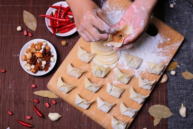 Dumplings stuffed with meat, ravioli, dumplings. dumplings with stuffing. dumpling ingredients,chinese cuisine