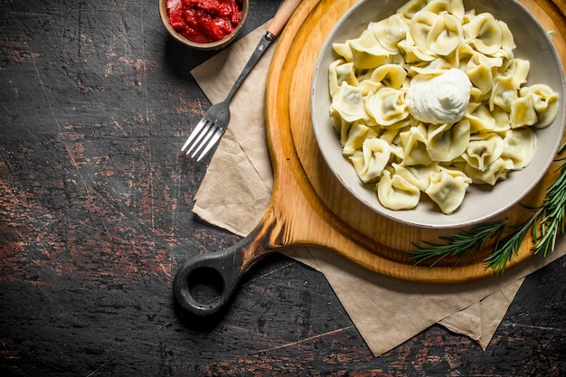 Dumplings with sour cream and rosemary.