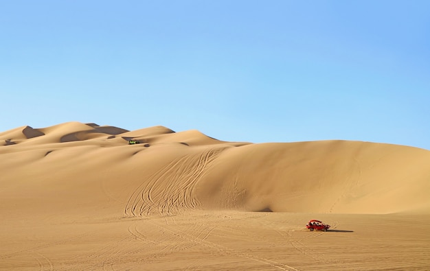 Dune buggies running on the amazing huacachina sand dunes in ica region, peru, south america Premium Photo