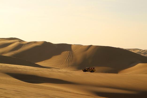 Dune buggy riding, popular activity on the beautiful sand dune of huacachina, ica, peru
