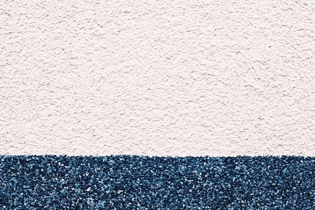 Двухцветная штукатурка стены текстуры как крупный план детали гранж