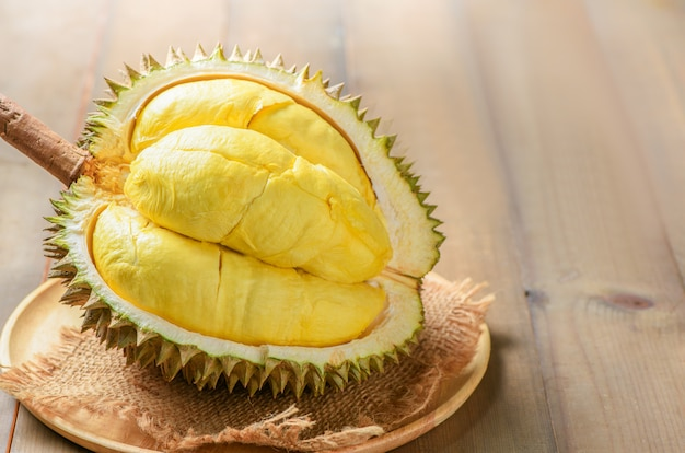 Durian or durio zibthinus murray on wood plate. king of fruits of thailand in summer season