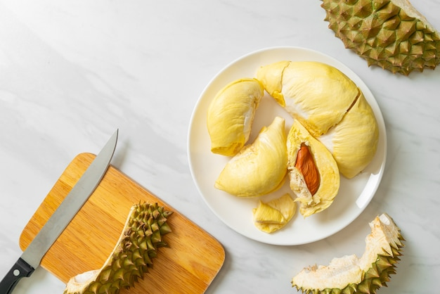 Durian riped and fresh ,durian peel on white plate