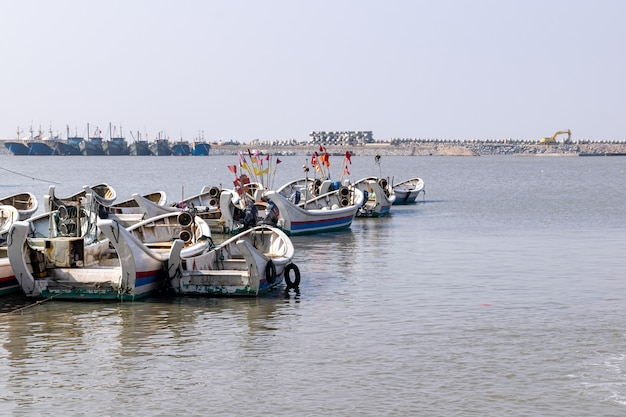 During the fishing moratorium, the fishing boat docked at the seaside