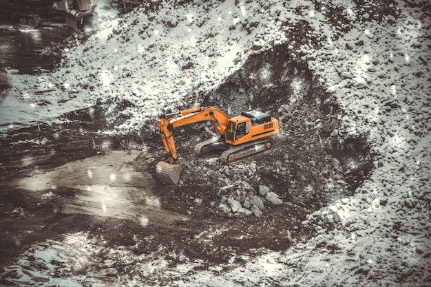 During snowfall machine for breaking stones in a granite quarry