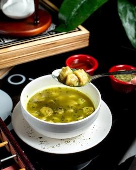 Dushbara soup with herbs