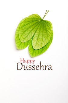 Dussehra greeting card using apta / bauhinia racemosa