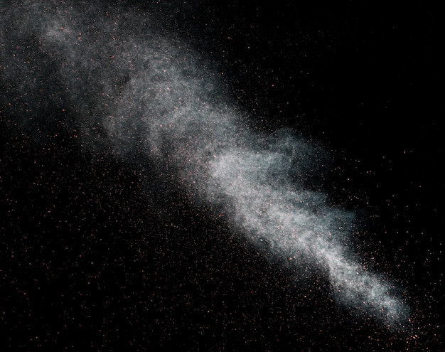 Dust explosion on a black background