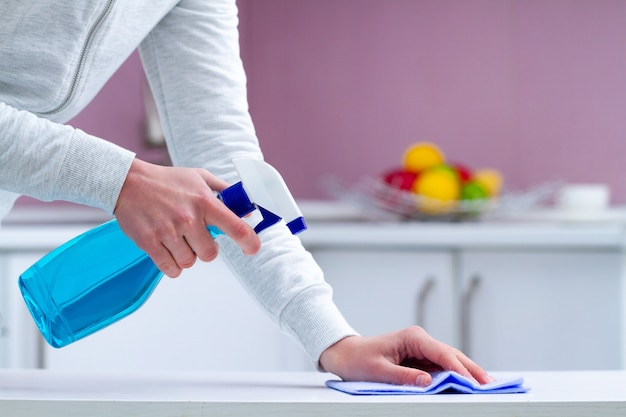 Dusting and polish furniture using cleaning products and cleaning supplies at home