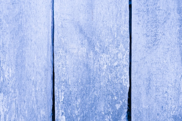 Dusty blue background of wooden boards