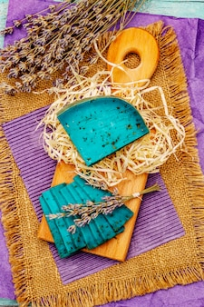 Dutch blue cheese with lavender on turquoise wooden background