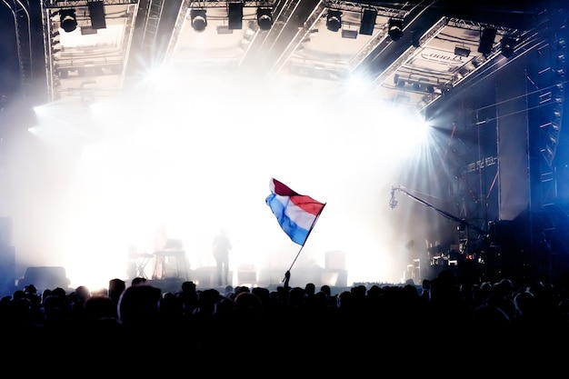 Dutch flag at the concert opposite the light from the stage