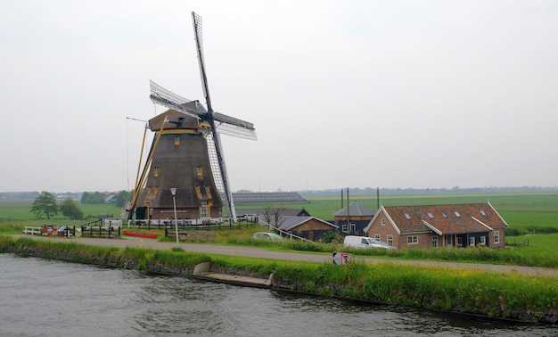 Dutch windmills in kinderdijk, a famous village in the netherlands where you can visit the old traditional windmills