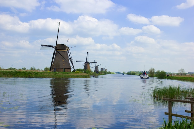Dutch windmills reflecting in river, kinderdijk, holland