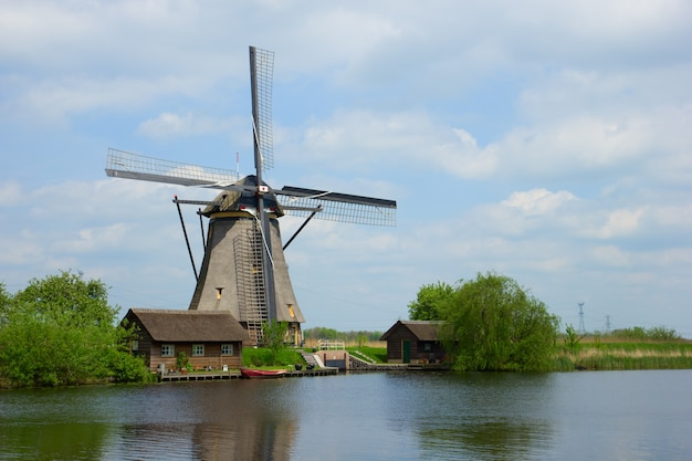 Dutch windmills on river bank, kinderdijk, holland