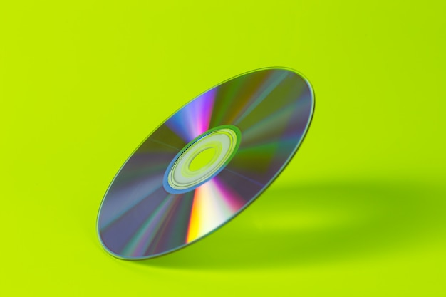Dvd disc isolated in neon green background