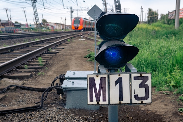 Dwarf railway signal on the railroad switch is shining blue that prohibits shunting movement