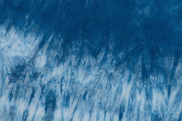 Окрашенный фон ткани индиго и текстурированный