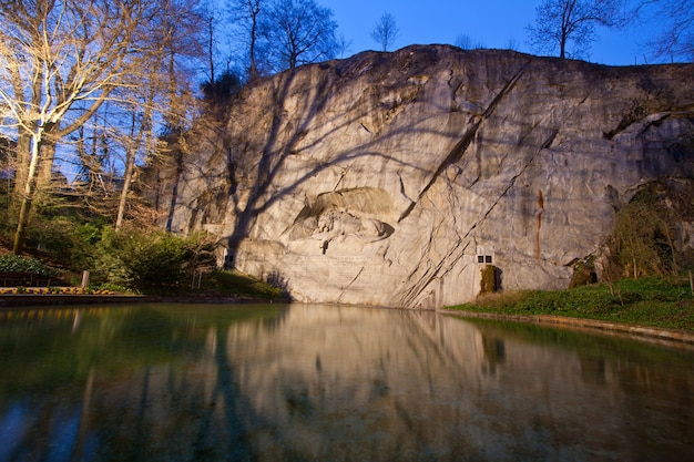 Dying lion monument in lucern switzerland at dusk