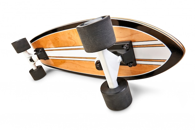 Dynamic side view of a black and wooden skate board isolated