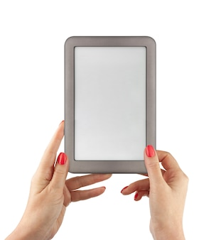E-book reader in female hands. include clipping path for screen and book with hands.