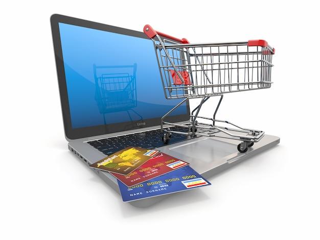 Eコマース。ノートパソコンのショッピングカートとクレジットカード