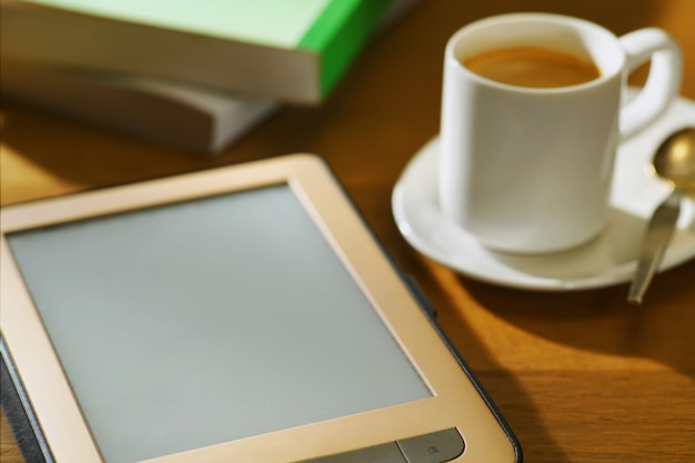 E-reader with cup of coffee